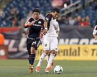 Real Salt Lake midfielder Javier Morales (11) on the attack. New England Revolution midfielder Lee Nguyen (24) earns a yellow card. In a Major League Soccer (MLS) match, Real Salt Lake (white)defeated the New England Revolution (blue), 2-1, at Gillette Stadium on May 8, 2013.
