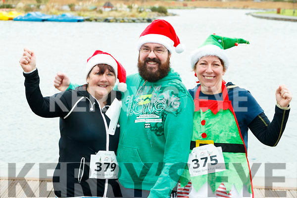 Jackie and James Treanor (Listellick, Tralee) with Nuala Horgan, Finuge, who took part in the Santa Run at Tralee Bay Wetlands on Sunday morning last.
