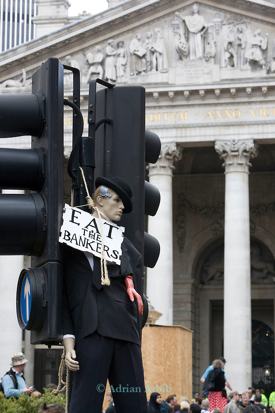 A manakin of a Banker is strung up in front of the Bank of England.<br />  Thousands of protesters marched on the city of London during the G20 conference meeting  in London April 2009 , RBS  Bank windows were smashed on the ground floor. Police made around 90 arrests.