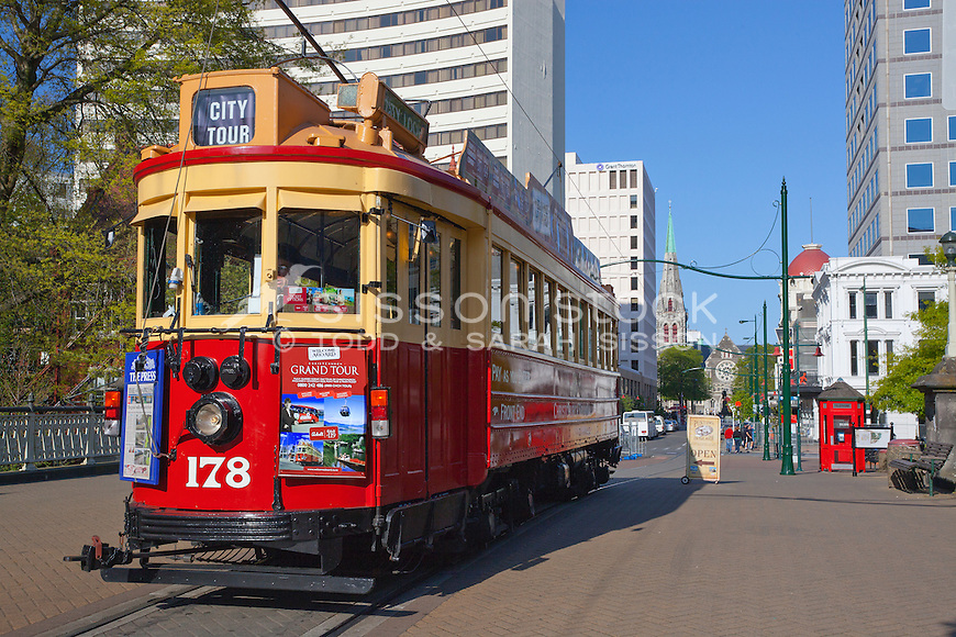 Historic Christchurch tram leaving Cathedral Square, Canterbury, New Zealand (pre February 2011 earthquake) - stock photo, canvas, fine art print