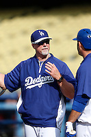 Los Angeles Dodgers batting coach Mark McGwire #12 before a game against the Colorado Rockies at Dodger Stadium on April 30, 2013 in Los Angeles, California. (Larry Goren/Four Seam Images)