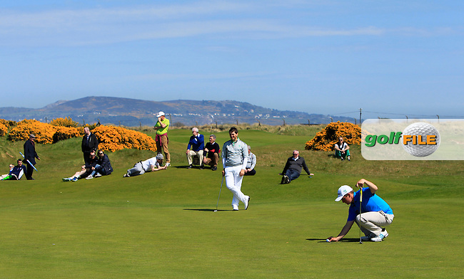 Colm Campbell Jnr. (Warrenpoint) and Jack Hume (Naas) on the 14th green during Round 4 of the Flogas Irish Amateur Open Championship at Royal Dublin on Sunday 8th May 2016.<br /> Picture:  Golffile / Thos Caffrey
