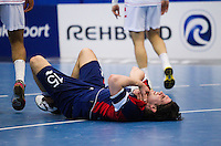 06 APR 2012 - LONDON, GBR - Great Britain's Martin Hare (GBR)  (centre, #15, in blue and red) recovers after finding his path to goal blocked by Tunisia's Mosbah Sanai (TUN) (left) and Tunisia's Oussama Hosni (TUN) (right)  during the men's 2012 London Cup match at the National Sports Centre in Crystal Palace, Great Britain .(PHOTO (C) 2012 NIGEL FARROW)