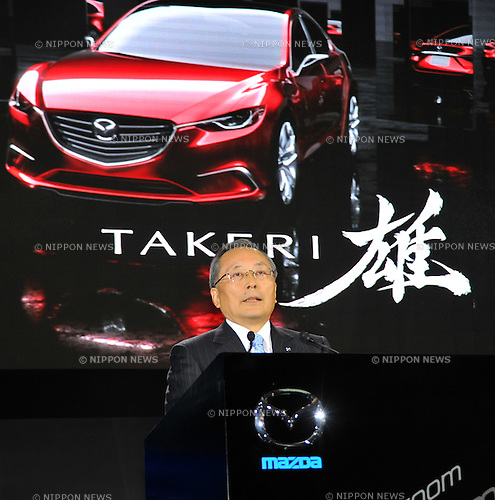 November 30, 2011, Tokyo, Japan - Takashi Yamauchi, president of Japans Mazda, introduces Takeri, the new generation sedan concept, during a press preview of the Tokyo Motor Show on Wednesday, November 30, 2011. .The Tokyo Motor Show opened to the press Wednesday as Japanese automakers unveiled a bevy of electric cars and other green vehicles at a much smaller venue in central Tokyo, to which the show moved from the nations largest exhibition hall in neighboring Chiba prefecture after 24 years. A total of 176 brands from 13 countries and regions participated in the show. The number of foreign automakers has increased to 24 from previous nine. Out of 398 models, 52 will be shown for the very first time. An estimated 800,000 visitors are expected to attend the week-long exhibition, compared with 1.5 million in 2005, according to the organizers.(Photo by Natsuki Sakai/AFLO) [3615] -mis-.