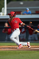 Moises Castillo (7) of the Johnson City Cardinals follows through on his swing against the Burlington Royals at Burlington Athletic Stadium on July 15, 2018 in Burlington, North Carolina. The Cardinals defeated the Royals 7-6.  (Brian Westerholt/Four Seam Images)