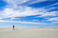 German girl walking on dunes at Farewell spit, New Zealand