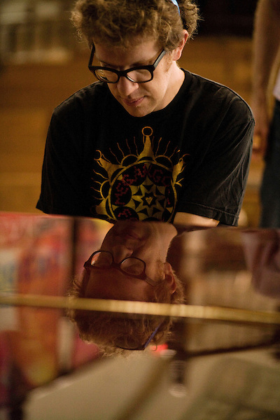 September 14, 2010.  Durham, North Carolina.. Phil Cook, of Megafaun, tries out the piano.. Day One of Sounds of the South, a reinterpretation of Alan Lomax's field recordings, with music by Megafaun, Fight the Big Bull, Sharon Van Etten and Justin Vernon of Bon Iver..