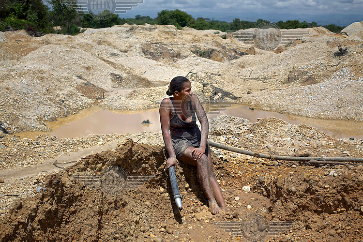 A miner rests in a gold mine in Bolivar Department on the banks of the Magdalena River.