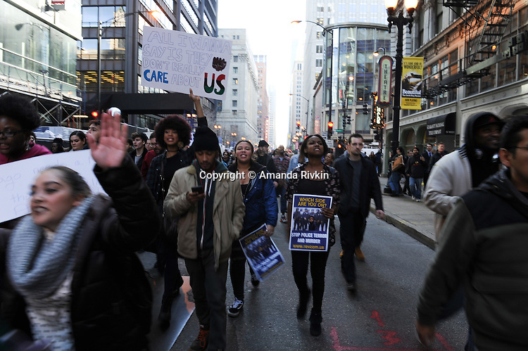 Protesters calling on Chicago Mayor Rahm Emanuel to resign on Randolph Street in the Loop in Chicago, Illinois on December 9, 2015.  Emanuel offered a historic apology for the police killing of Laquan McDonald and police brutality and racial profiling generally -- without using those words -- in front of the City Council in the morning.
