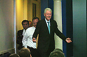 Former United States President Bill Clinton Clinton enters the Press Room followed by White House staff to meet reporters in the White House Press Room in Washington, DC Friday 10 December 2010. Clinton endorsed the tax compromise Obama made with Republican congressional leaders..Credit: Bill Auth / Pool via CNP