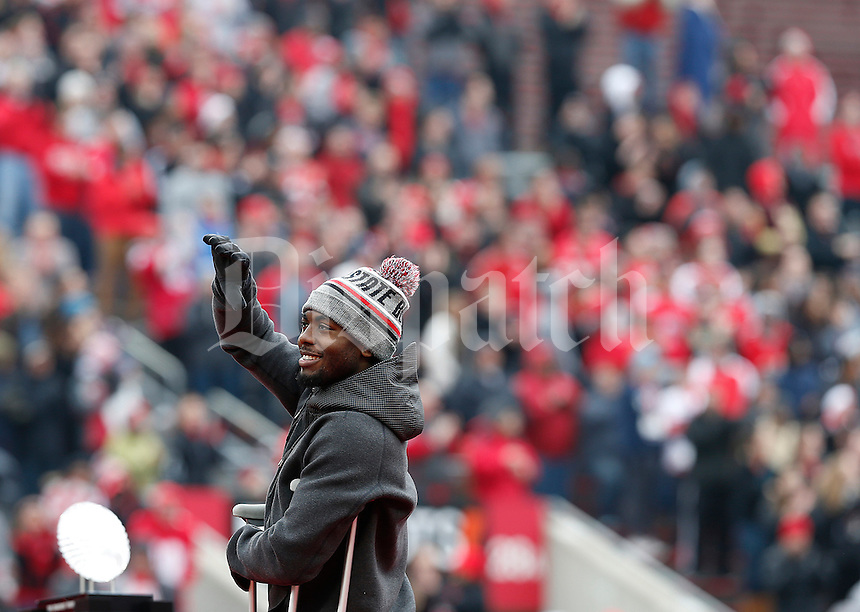 Quarterback J.T. Barrett waves to the crowd during the Ohio State Football National Championship Celebration at Ohio Stadium, Saturday morning, January 24, 2015. More than 40 thousand fans packed the lower stands in the stadium to celebrate the National Championship win with the football team. (The Columbus Dispatch / Eamon Queeney)