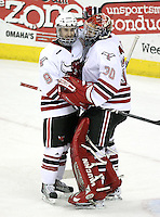 UNO's Rich Purslow congratulates goalie John Faulkner at the end of the game. Faulkner finished with 33 saves to earn a school-record and NCAA-leading sixth shutout. UNO beat St. Cloud State 3-0 Friday night at Qwest Center Omaha.  (Photo by Michelle Bishop)