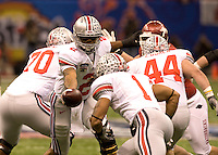 Terrelle Pryor of Ohio State gives the ball to Daniel Herron during the game against Arkansas during 77th Annual Allstate Sugar Bowl Classic at Louisiana Superdome in New Orleans, Louisiana on January 4th, 2011.  Ohio State defeated Arkansas, 31-26.