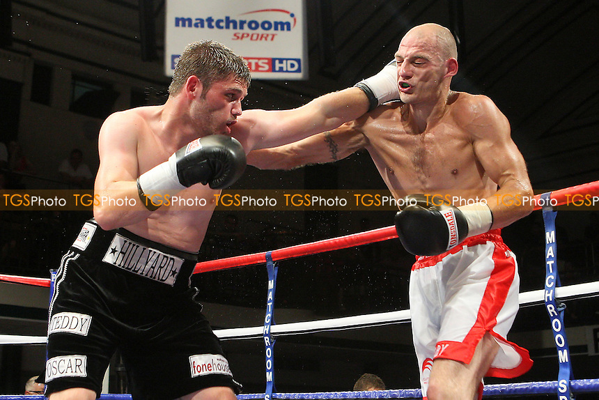 George Hillyard (black shorts) defeats Keiron Grey in a Light-Middleweight boxing contest at York Hall, Bethnal Green, promoted by Matchroom Sports / Barry Hearn - 09/07/10 - MANDATORY CREDIT: Gavin Ellis/TGSPHOTO - Self billing applies where appropriate - Tel: 0845 094 6026