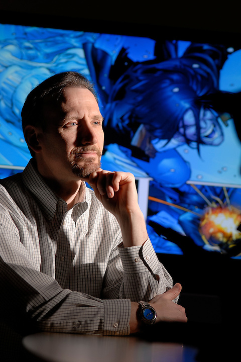 On April 11, 2006, Brian Raffel, co-founder and studio head of Raven Software, is pictured in front of a projected video graphic from one of the company's games in the background. The video gaming company based in Madison, Wis.