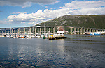 Boats at moorings by bridge the harbour at Tromso, Norway