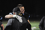 Derek Snell hugs a coach following the game.  Photo for the Star by  Michael Dinneen.