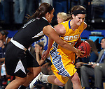 BROOKINGS, SD - MARCH 20:  Steph Paluch #15 from South Dakota State has the ball knocked from her hands by Taylor Schippers #1 from Butler in the first half of their WNIT game Thursday evening at Frost Arena in Brookings.(Photo by Dave Eggen/Inertia)
