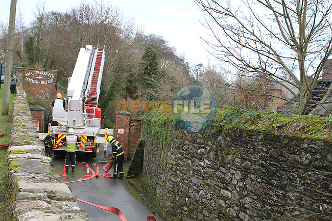 Scene of a Fire on the Annagassin road in Castlebellingham, Co.Louth which was attended last night by Fire Units from Ardee, Dundalk, Dunleer and Drogheda.  It was later attended to by the Army Bomb Disposal Unit and a viable device was located.  The fire service which had left the scene has returned as the fire reignited...(Photo credit should read Jenny Matthews www.newsfile.ie)....This Picture has been sent you under the conditions enclosed by:.Newsfile Ltd..The Studio,.Millmount Abbey,.Drogheda,.Co Meath..Ireland..Tel: +353(0)41-9871240.Fax: +353(0)41-9871260.GSM: +353(0)86-2500958.email: pictures@newsfile.ie.www.newsfile.ie.