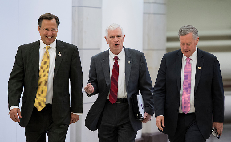 UNITED STATES - FEBRUARY 15: From left, Rep. Dave Brat, R-Va., Rep. Mo Brooks, R-Ala., and Rep. Mark Meadows, R-N.C., chair of the House Freedom Caucus, arrive for the news conference on Affordable Care Act replacement legislation on Wednesday, Feb. 15, 2017. (Photo By Bill Clark/CQ Roll Call)