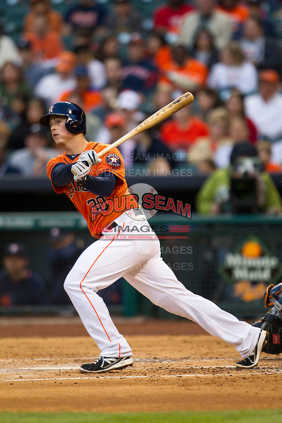 Houston Astros third baseman Matt Dominguez (30) follows through on his swing during the MLB baseball game against the Detroit Tigers on May 3, 2013 at Minute Maid Park in Houston, Texas. Detroit defeated Houston 4-3. (Andrew Woolley/Four Seam Images).
