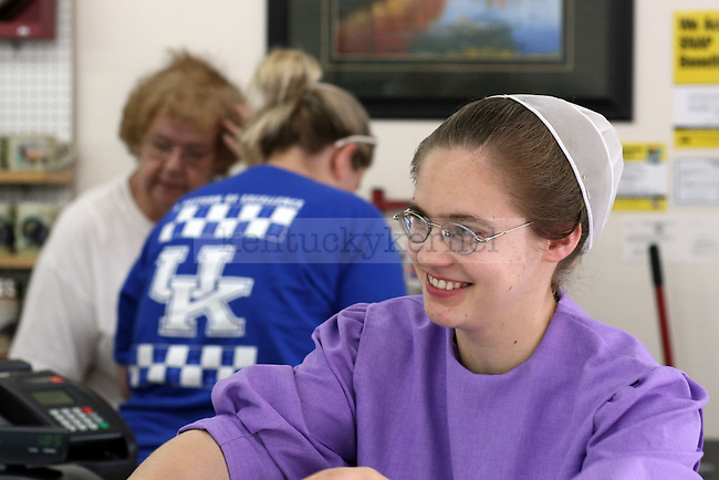9/19/09.Hindman, KY.Smiling Mennonite woman with customers.