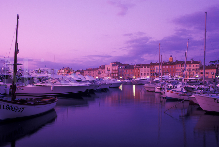 France, St. Tropez, Cote d' Azur, Provence, harbor, Var, Europe, Yachts docked in the harbor of Saint Tropez at sunset on the Mediterranean Sea.