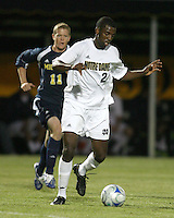 Aaron Maund #2 of the University of Notre Dame moves the ball away from Cam Cameron #11 of the University of Michigan during a men's NCAA match at the new Alumni Stadium on September 1 2009 in South Bend, Indiana. Notre Dame won 5-0.
