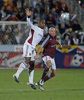 Real Salt Lake's Jamison Olave and Colorado's Conor Casey (red) fight for ball. Real Salt Lake earned a tied versus the Colorado Rapids securing a place in the postseason. Dick's Sporting Goods Park, Denver, Colorado, October, 25, 2008. Photo by Trent Davol/isiphotos.com