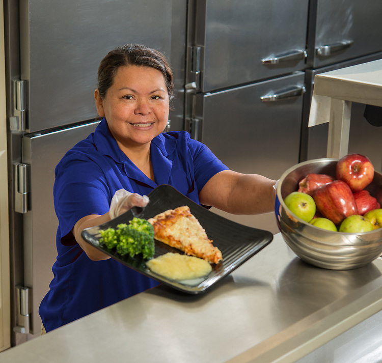 Susana Samaniego poses for a photograph in the cafeteria at Walnut Bend Elementary School, July 17, 2014.