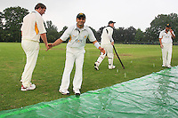 The covers are brought on as torrential rain falls - Harold Wood CC vs Shenfield CC - Essex Cricket League at Harold Wood Park - 27/06/09- MANDATORY CREDIT: Gavin Ellis/TGSPHOTO - Self billing applies where appropriate - 0845 094 6026 - contact@tgsphoto.co.uk - NO UNPAID USE.