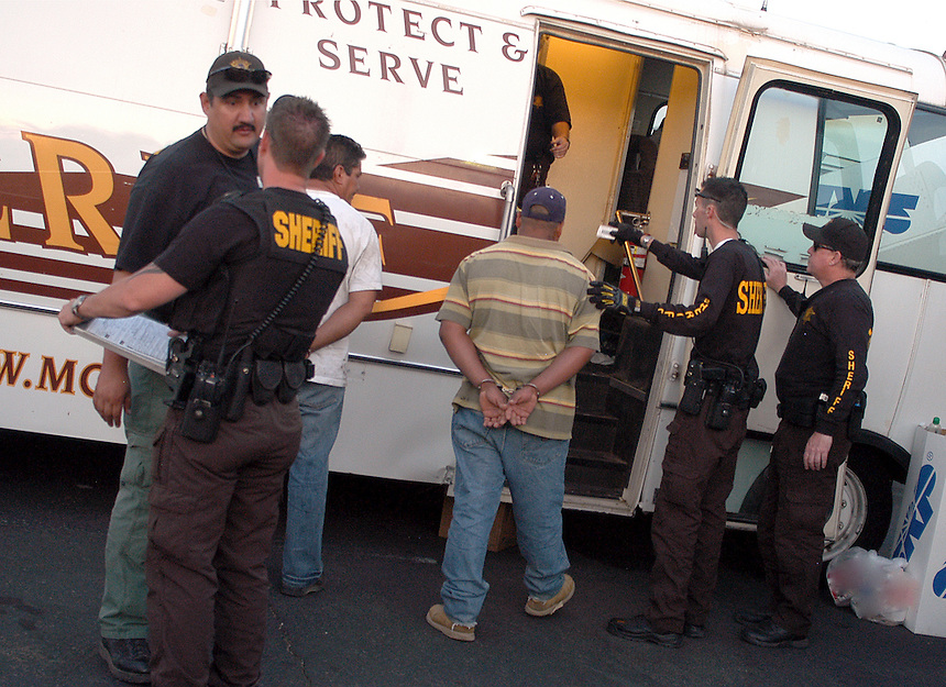An Undocumented person is being booked on one of Sheriff Joe Arpaio's Round Up Sweeps..Photo by AJ Alexander