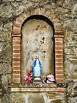 Small roadside shrine, small Italian village of Mezzana, Tuscano, Italy