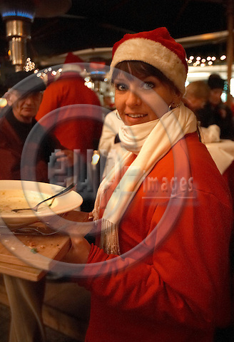 """BERLIN - GERMANY 19. DECEMBER 2006 -- Weihachts Zauber Gendarmenmarkt - Christmas Attraction - Christmas Market at Gendarmen Market -  A waitress with a pixy hat -- PHOTO: CHRISTIAN T. JOERGENSEN / EUP & IMAGES..This image is delivered according to terms set out in """"Terms - Prices & Terms"""". (Please see www.eup-images.com for more details)"""