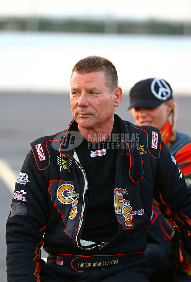 Feb 13, 2016; Pomona, CA, USA; NHRA funny car driver Jim Campbell reacts after qualifying for his first career race during the Winternationals at Auto Club Raceway at Pomona. Mandatory Credit: Mark J. Rebilas-USA TODAY Sports