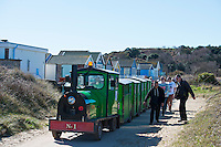 BNPS.co.uk (01202 558833)<br /> Pic: RachelAdams/BNPS<br /> <br /> The train dropping people off on Mudeford Spit.<br /> <br /> There was outrage today after a family that has run one of Britain's first 'Noddy' land trains for 46 years were served with a notice to quit the service.<br /> <br /> The much-loved novelty train that carries people to a remote beach was started in 1968 by the late Roger Faris, who hand-built the carriages himself.<br /> <br /> Since his death 34 years ago his widow Joyce, 88, has operated the independent service for 364 days a year and runs it more as a hobby than a profitable business.<br /> <br /> The little train has been used by generations of people and become a popular fixture at the Hengistbury Head beauty spot in Dorset.<br /> <br /> Now after five decades of service, town hall officials have told Mrs Faris they will not be renewing their contract with her as they intend to operate their own train service.