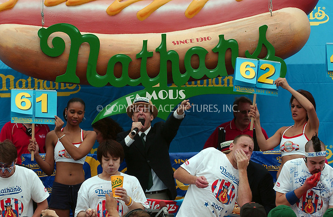 WWW.ACEPIXS.COM . . . . .....July 4, 2007. New York City.....Takeru Kobayashi of Japan and Joey Chestnut of San Jose participate in the International July Fourth Hot Dog Eating Contest at Coney Island, NY.....Chestnut defeats six time winner Takeru Kobayashi and sets a record of eating 66 hot dogs in 12 minutes...  ....Please byline: Kristin Callahan - ACEPIXS.COM..... *** ***..Ace Pictures, Inc:  ..Philip Vaughan (646) 769 0430..e-mail: info@acepixs.com..web: http://www.acepixs.com