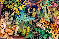 A painting at the headquarters of 'Traffic', an international non-governmental organisation fighting illegal wildlife trade. The painting shows people interacting with tigers who are frequently targeted by traffickers.