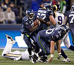 Seattle Seahawks quarterback Tarvaris Jackson scrambles against the St. Louis Rams at  CenturyLink Field in Seattle, Washington on December 12, 2011. The Seahawks beat the Rams 30-13. ©2011 Jim Bryant Photo. All Rights Reserved.