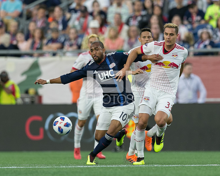 Foxborough, Massachusetts - June 2, 2018: First half action. In a Major League Soccer (MLS) match, New England Revolution (blue/white) vs New York Red Bulls (white), at Gillette Stadium.