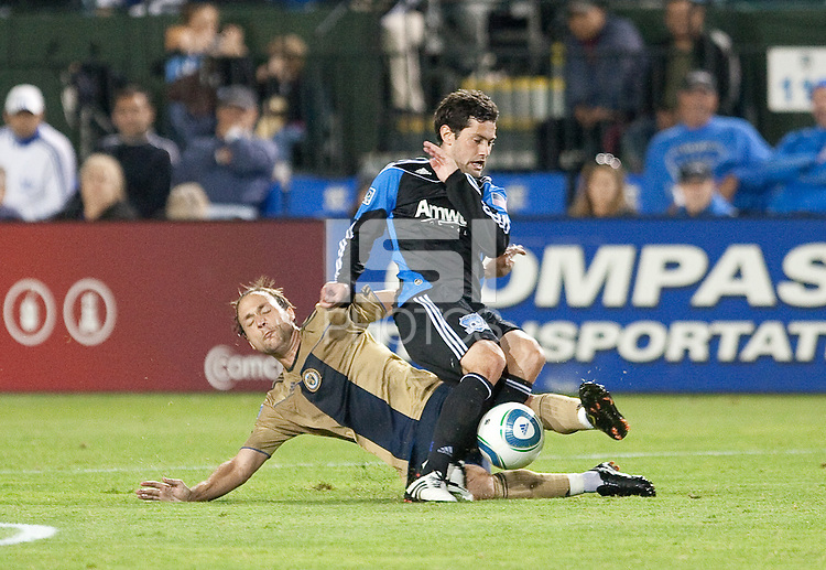 Justin Mapp slide tackles Joey Gjertsen. The San Jose Earthquakes defeated the Philadelphia Unioin 1-0 at Buck Shaw Stadium in Santa Clara, California on September 15th, 2010.