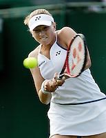 28-6-06,England, London, Wimbledon, first round match,  Michaella Krajicek