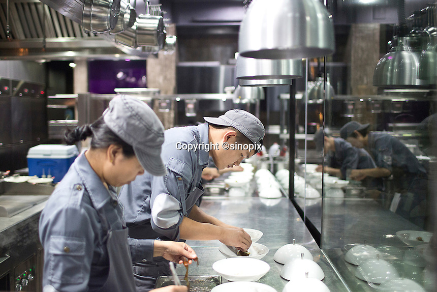 Kitchen work at the Ultraviolet restaurant in Shanghai, China on27th Sept 2013.  The restaurant in run by Chef Paul Pairet. <br /> <br /> Photo by Qilai Shen / Sinopix