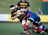 Tulele Masoe is tackled by Lachlan Douglas and Zuriel Togiatama. Counties Manukau Premier 1 McNamara Cup Final between Ardmore Marist and Bombay, played at Navigation Homes Stadium on Saturday July 20th 2019.<br />  Bombay won the McNamara Cup for the 5th time in 6 years, 33 - 18 after leading 14 - 10 at halftime.<br /> Photo by Richard Spranger.