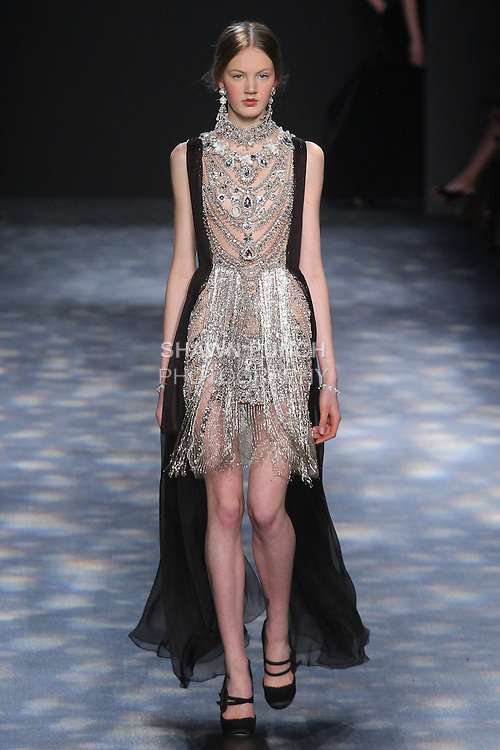 Model Noa walks runway in a crystal and antique silver jeweled necklace cocktail with bugle bead fringe and black chiffon Grecian drape, from the Marchesa Fall 2016 collection by Georgina Chapman and Keren Craig, presented at NYFW: The Shows Fall 2016, during New York Fashion Week Fall 2016.