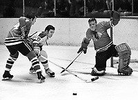 Seals Ernie Hicke tries to score on Chicago Blackhawks goalie Ken Brown and #4 Doug Jarrett. (1970 photo/Ron Riesterer)