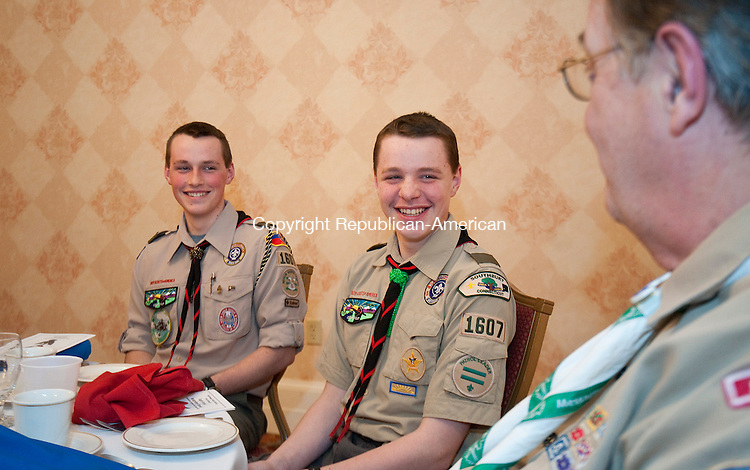 TORRINGTON,  CT-021315JS11- 2014 Eagle Scout Matthew Mallon, 17 of Troop 1607 in Southbury, left, and his brother Brendan Mallon, 13, chat with advisor Dave Rohlfing, right, during the Northwest Hills District's Eagle Scout Recognition Dinner Friday hosted by, and held at, the Torrington Elks Lodge #372.  <br />  Jim Shannon Republican-American