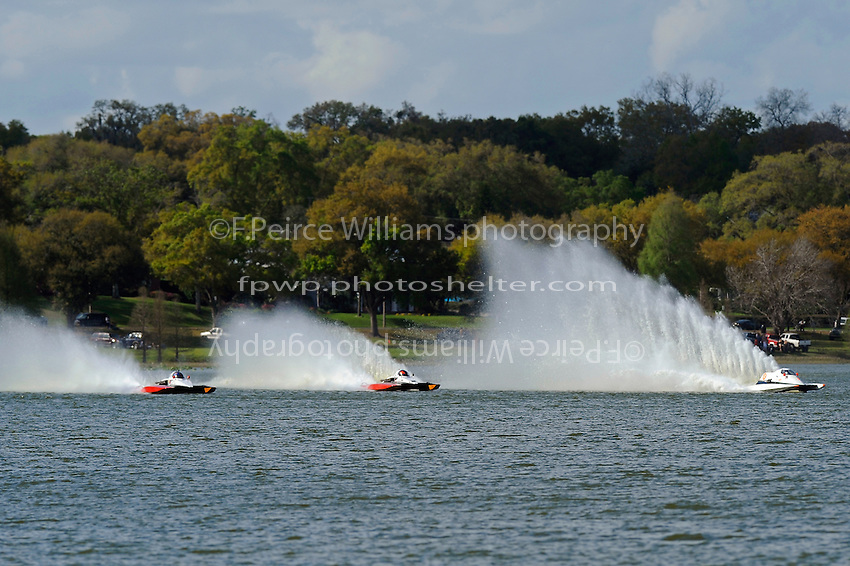 """(L to R): Tom Thompson, A-52 """"Fat Chance Too"""", George Kennedy, Jr., A-25 """"Fat Chance"""" and Brandon Kennedy, A-7 """"Southern Magic"""". (2.5 MOD class hydroplane(s)"""