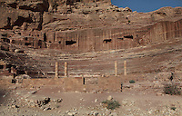 Main Theatre at Petra, Ma'an, Jordan. Mountain with tomb facades is visible in the background. The theatre is designed on principles laid down by Roman architect Vitruvius but carved into the rock rather than being built.  The complex was originated with a Nabatean theatre built in 1st century BC but was altered by the Romans in 2nd century AD following a more Greco-Roman design. The theatre seated 6000 people. Petra was the capital and royal city of the Nabateans, Arabic desert nomads. Picture by Manuel Cohen