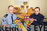 Sergent Leo Randles and Garda Stephen Horgan of Killarney Garda Station with confiscated Fireworks.